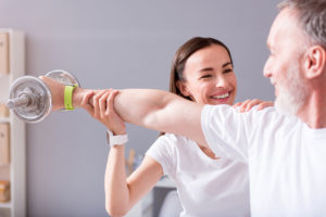 Physiotherapist assisting with exercises for rehab